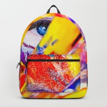 women-with-paint-on-her-hands-and-face-backpacks